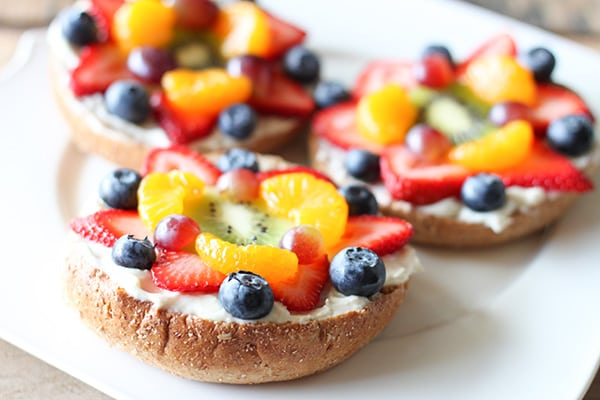 Bagel Fruit Pizzas - colorful fresh fruit layered with lemony cream cheese on a whole wheat bagel.
