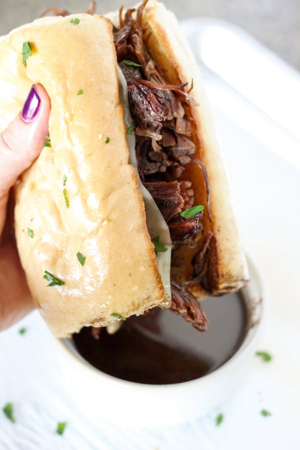 Instant Pot French Dip Sandwich - Tender chunks of beef roast topped with melty cheese on a toasted garlic bread roll!