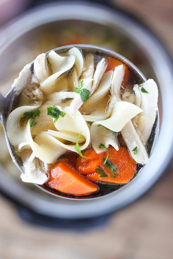 Instant Pot Pressure Cooker Chicken Noodle Soup -Tender chunks of chicken in a rich homemade chicken broth with big hearty veggies.