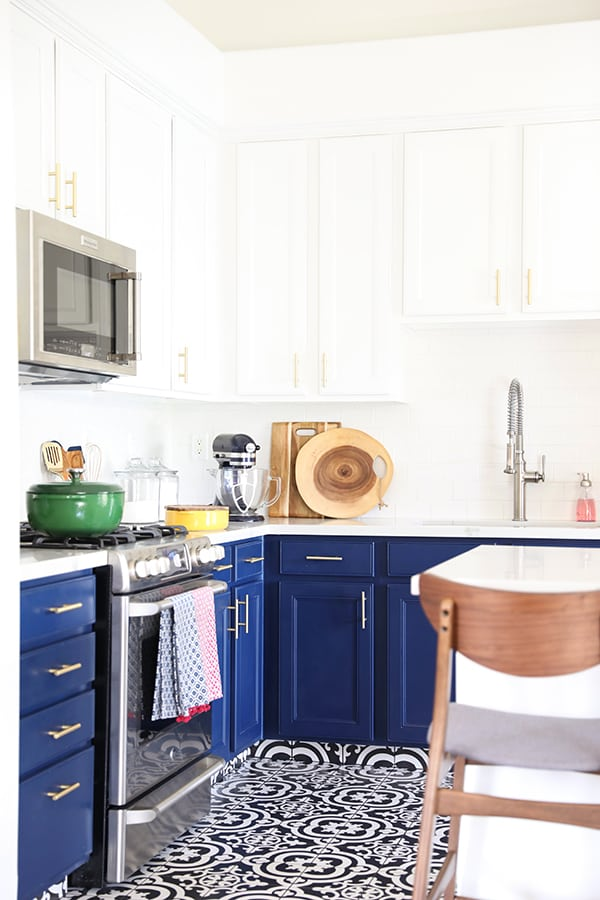 Navy Blue Kitchen Cabinets, Black and White Tile Floor and Gold Cabinet Hardware