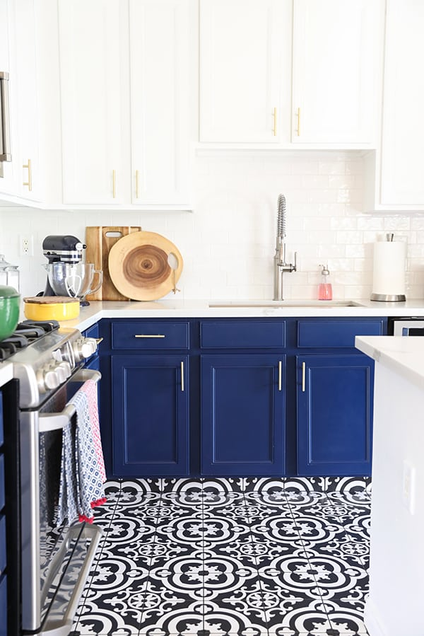 Navy Blue Kitchen Cabinets, Black and White Tile Floor and Gold Hardware