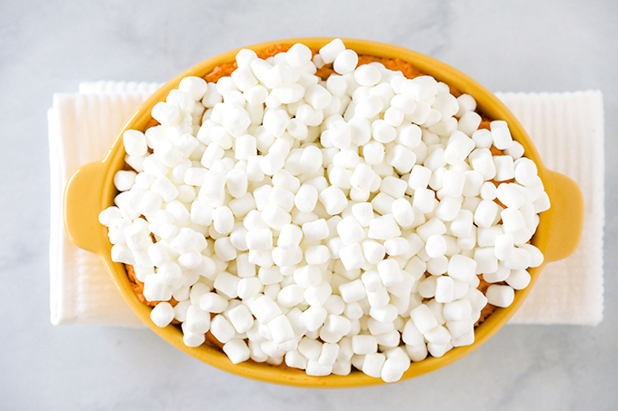 Sweet Potato Casserole -Fresh sweet potatoes mashed with butter and heavy cream, mixed with toasted pecans and and topped with toasted marshmallows.