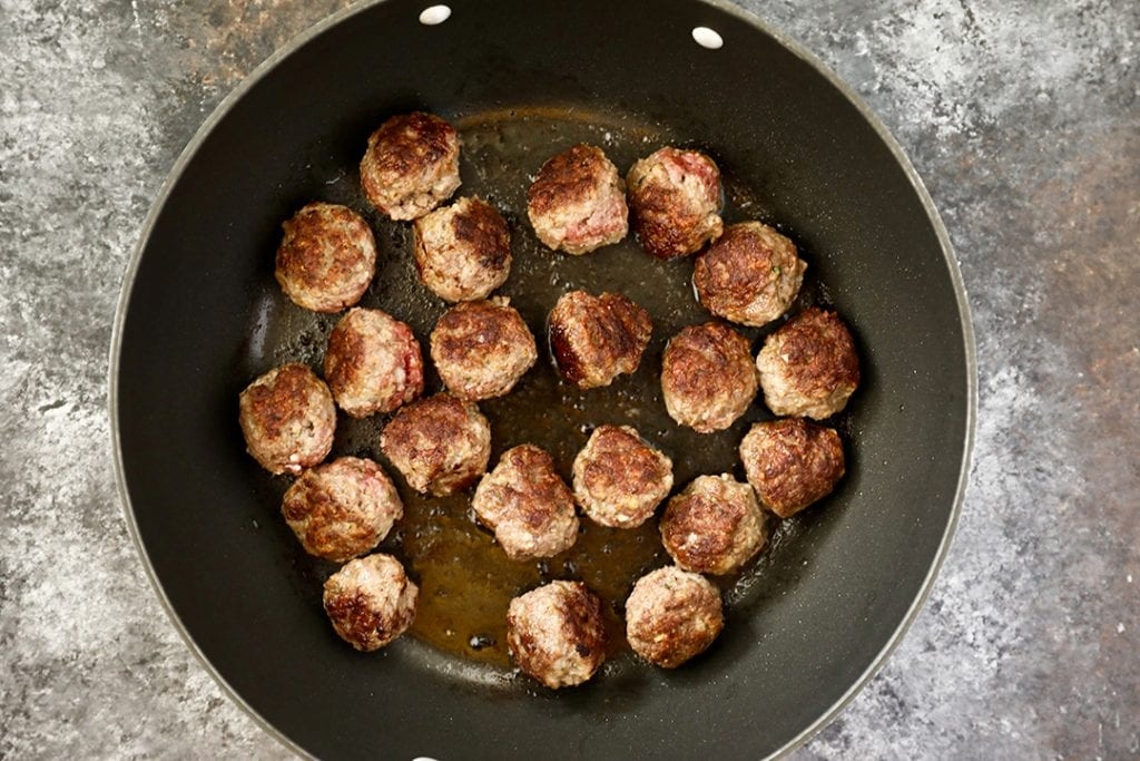 Meatballs Browning in Skillet