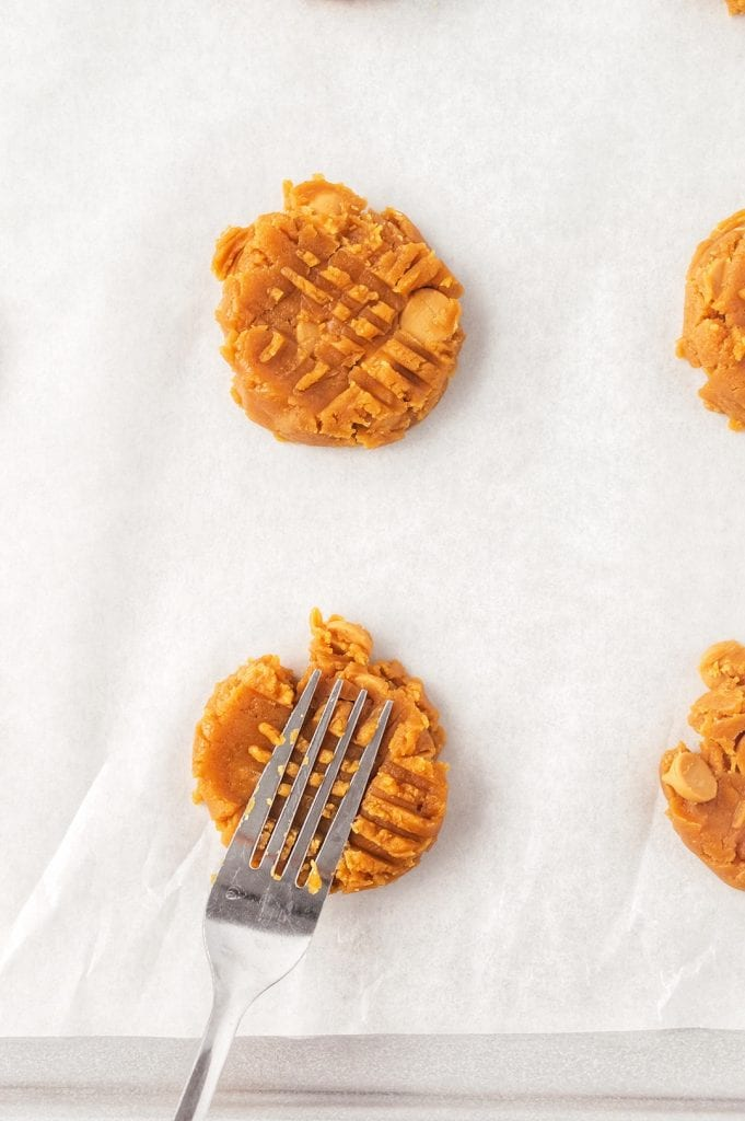 Pressing Peanut Butter Cookie Dough with Fork Before Baking